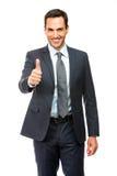Lächelnder Daumen des Geschäftsmannes oben Stockbilder