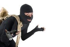 Lächelnder Dieb hilflos vor seinem Job Lizenzfreie Stockfotografie