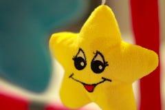 Lächelnder gelber Stern Stockfotos