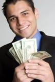 Lächelnder Geld-Mann lizenzfreie stockbilder