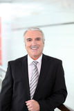 Lächelnder Geschäftsmann Lizenzfreie Stockfotos