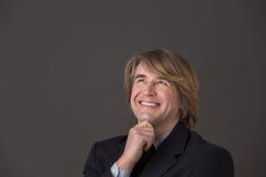 Lächelnder Geschäftsmann von mittlerem Alter stockfotografie