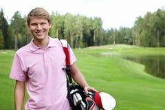 Lächelnder Golfspieler Stockfotos