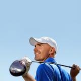 Lächelnder Golfspieler Stockfotografie