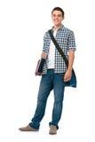 Lächelnder Jugendlicher mit einer Schultasche stockfotografie