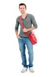 Lächelnder Jugendlicher mit einer Schultasche Stockfotos