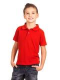 Lächelnder Junge, der als Art und Weisebaumuster aufwirft. Stockbilder