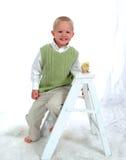 Lächelnder Junge und Huhn Lizenzfreie Stockfotos
