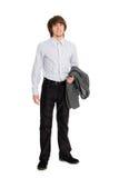 Lächelnder junger Mann, der eine Jacke anhält Lizenzfreies Stockbild