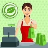 Lächelnder Kassierer Girl am Eco-Grün-Speicher Lizenzfreies Stockfoto