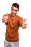 Lächelnder Kerl, der sich Daumen zeigt Stockbilder