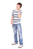 Lächelnder Kerl mit einem Telefon stockbilder
