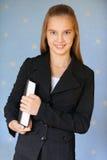 Lächelnder Mädchenjugendlicher mit Buch Lizenzfreies Stockfoto