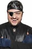 Lächelnder Mann in einem Piratenkostüm Stockfotografie