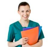 Lächelnder medizinischer weiblicher Doktor Stockfoto