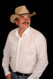 Lächelnder mittlerer gealterter Cowboy Lizenzfreie Stockfotos