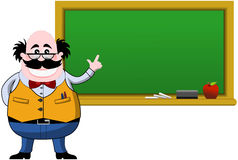 Lächelnder Professor Indicating Blank Blackboard Stockbild