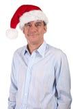Lächelnder stattlicher Mann im Sankt-Hut stockfoto