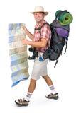 Lächelnder Wanderer mit Karte Stockfotos