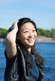 Lächelndes asiatisches Mädchen Lizenzfreies Stockfoto