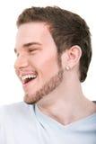 Lächelndes Gesicht des jungen Mannes Stockbild