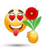 Lächelndes Gesicht mit Blumenstrauß in der Hand Stockfotografie
