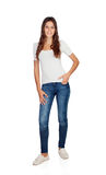 Lächelndes junges Mädchen mit der Jeans-Stellung Stockfoto