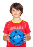Lächelndes Kindgebläse des spanischen Teams Stockbild