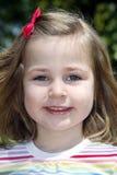 Lächelndes kleines Mädchen Stockbilder
