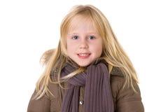Lächelndes kleines Mädchen mit toothy Lächeln Lizenzfreie Stockfotos