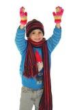 Lächelndes kleines Mädchen mit Winterkleidung Stockfotos