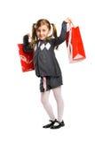 Lächelndes Mädchen mit einer Einkaufstasche Stockfotos