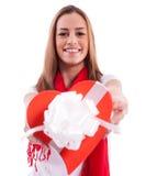 Lächelndes Mädchen mit Geschenkherzen Stockbilder