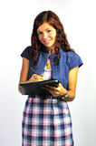 Lächelndes Mädchen mit Klemmbrett Lizenzfreie Stockfotografie