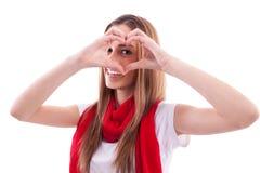 Lächelndes Mädchen zeigt Herz mit den Händen Lizenzfreie Stockfotos