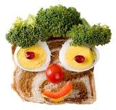 Lächelndes Nahrungsmittelgesicht Stockfoto