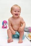 Lächelndes Schätzchen auf potty Lizenzfreie Stockfotografie