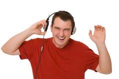 Lächelnmann in den Kopfhörern Lizenzfreies Stockbild
