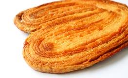 Läcker fransk mer palmier kaka- eller för kaka för elefantöra isolat på vit bakgrund fotografering för bildbyråer