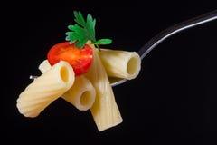 Läcker pasta och tomat Fotografering för Bildbyråer