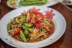 Läckert för thailändsk kokkonst för Papayasallad kryddigt, Somtam Arkivfoton