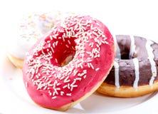 Läckra donuts med stänk Royaltyfri Bild