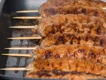 Läckra köttfärssteknålar arkivbilder