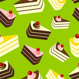 Läckra kakor på grön bakgrund, sömlös modell Royaltyfria Foton