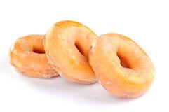 Läckra och nya donuts för frukost arkivbild