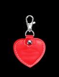 Läder runda Keychain med gemlåset för tangent som isoleras på svart Royaltyfri Fotografi