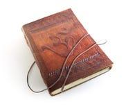 Läderanteckningsbok med ett tecken Om Arkivbilder