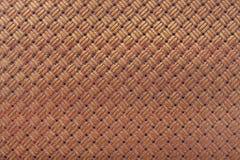Läderbakgrund med flätad samman design Fotografering för Bildbyråer
