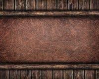 Läderbakgrund som inramas av gamla träplankor Royaltyfri Bild