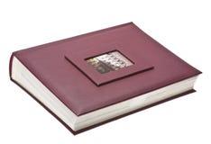 Läderfotoalbum som isoleras på vit arkivbilder
